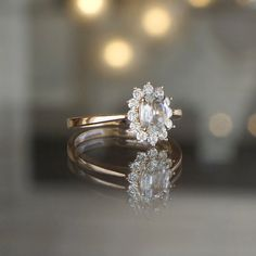 Oval White Sapphire and White Diamond Burst Halo Engagement Ring in 14k Rose Gold at Sarah O. Jewelry | Denver, CO