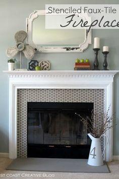 Stenciled tile fireplace surround. Beautiful.