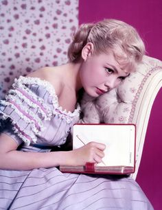 Sandra Dee writing. Dee (1942–2005) began her career as a model and progressed to film. She won a Golden Globe Award in 1959 as one of the year's most promising newcomers. She became known for her wholesome ingenue roles in such films as The Reluctant Debutante, Gidget, Imitation of Life, and A Summer Place.