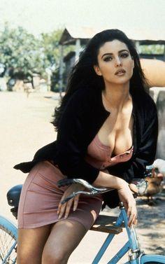 Monica Bellucci heaving bosom on a bike