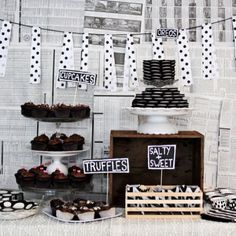 black and white party | Use newspapers as a backdrop potentially? Behind gift table or dessert table?