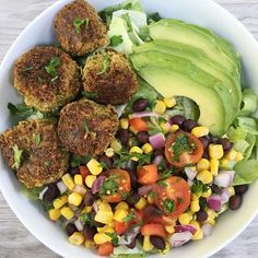 "When last night's leftovers become today's dinner salad. So yesterday's dinner included these amaaazing Mexican Vegan Falafel Bites.  Paired tonight with our Black Bean Veggie Salad and avocado on a bed of lettuce, this is leftovers at its finest!. . Recipe from @cottercrunch, the Falafel Bites were easy to make, and we're both #glutenfree & nearly grain-free (there's just 2 tbsp of gf flour) as the base is a broccoli/ cauliflower ""rice"". Lots of flavor, great texture and so delicious, my…"