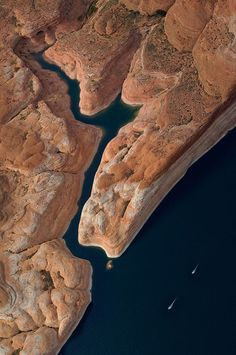 Jet Skis Race Past the Mouth of Narrow Side Canyon. Glen Canyon NRA, Lake Powell, Utah/Arizona, US. Aerial. - Lake-Powell -Arizona-USA - Mike Reyfman Photography