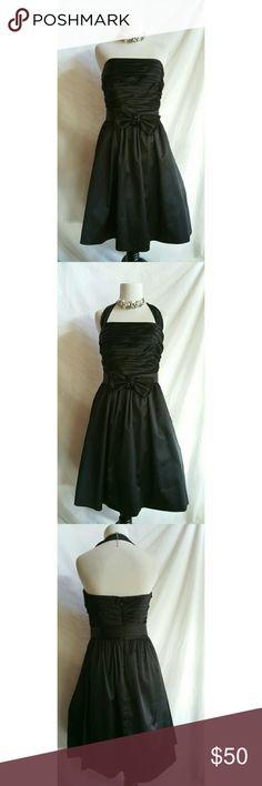 White House Black Market Size 6 Black Dress Gorgeous WHBM cocktail dress.  Skirt has built in crinoline.   Removable halter strap, makes dress strapless.   Back zipper.  Side pockets.   Polyester,  spandex.  Dry clean. White House Black Market Dresses Midi