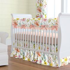 Springtime Floral Crib Bedding by Carousel Designs. A breath of Springtime! This cheerful collection will bring your nursery to life with its fabulous array of color and femininity. Shades of peach, coral and yellow make this the perfect floral for your special room. #carouseldesigns