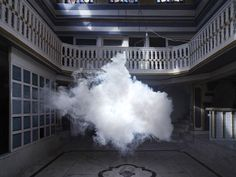 In his Nimbus clouds series, Smilde creates actual clouds, typically inside empty gallery spaces, and then photographs the results. The process is scientific, as he carefully regulates the temperature and humidity of a space to create ideal conditions for a cloud. After misting an area, he then sprays a short burst of fog to create a fluffy, albeit brief, cloud.