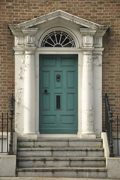 Georgian door. Not as bright as most, but I love the color. Would make a great (albeit expensive) decorative piece somehow!