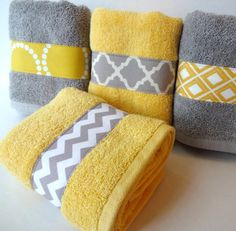Cheap and easy customization trick. Choose a style and then sew a favorite patterned ribbon/fabric onto your towels.