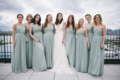 Adore these bridesmaid dresses - same color, same fabric, different styles.   Read More: http://www.stylemepretty.com/2014/10/30/chic-brooklyn-wedding-with-the-nyc-skyline/