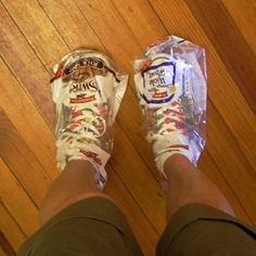 Wearing bread bags to cover shoes from the rain.