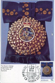 The Order of Australia was founded by The Queen as Queen of Australia in 1975. The badge is fashioned in the shape of a gold mimosa flower surmounted by a crown and the Sovereign's Badge worn by The Queen is embellished with diamonds