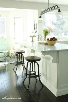 Love the corbels on the island.  And the marble counter.  And the stools...
