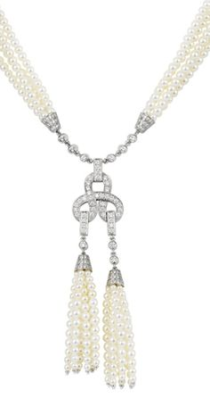 Cartier Agrafe Double Motif necklace in 18ct white gold with freshwater pearls and pavéd with diamonds.  Via The Jewellery Editor.