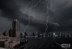 On July 25, 2016, New York City witnessed one of the most impressive lightning strikes ever photographed. An enormous bolt rocked Battery Park City in lower Manhattan and Jersey City in New Jersey, completely spanning the Hudson River - and I had my camera set up to capture it.  I've photographed dozens of storms, but as this particular one roared in from a distance, I knew it was going to be special. A beautiful wall cloud was quickly advancing in front of the rain curtain, electrifying ...