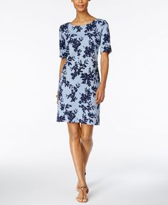 Dress to impress in Karen Scott's stunning floral-inspired sheath. | Cotton/polyester | Machine washable | Imported | Pullover styling | Hits above knee | Boat neckline; Sheath silhouette | Elbow slee
