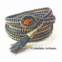 Five-wrap black and gold seed bead bracelet with Intaglio button and tassel by CrosslakeArtisans on Etsy