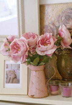 Large pink roses in a vintage enamel jug