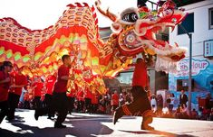 Celebrations in Los Angeles: Ring in the Year of the Ram with dragon parades, Chinese acrobats, and Disney characters decked out in traditional Chinese outfits -
