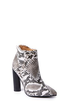 """If you've owned a pair of Snakeskin Ankle Boots, then you know how wonderful they are. If you haven't, then boy are you in for a treat!  Lightly textured snakeskin bootie features a pointed toe and 3"""" heel zipper.    •Heel measures 4.5"""" • Non-Skid Sole • Vegan friendly, man made materials • Imported"""