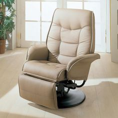 Coaster Berri Swivel Recliner With Flared Arms 7502 - Berri Swivel Recliner With Flared Arms By Coaster 7502 by CoasterSit back and relax with the superior comfort of this swivel recliner. The leatherette cushioned material is available in either a beige or black, making it possible to easily match existing living room decor. Flared tapered arms, plush tufted seating, a swivel motion. Fully reclined, this piece extends from 21 inches in depth to 60 inches, giving you room to stretch out…