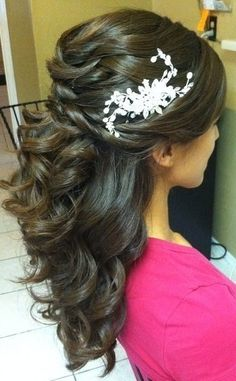 Wedding hair style for long hair with half up and half down.