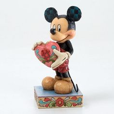 """Heartwood Creek by Jim Shore Disney Traditions A GIFT OF LOVE Mickey Mouse with Heart Figure Measures 4.75""""H x 2.5""""W x 2.25""""L Materials : Stone Resin Your Price: $24.00"""