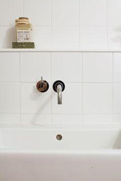 Wall-mounted bathroom faucet, tile, shelf: So simple, so beautiful.