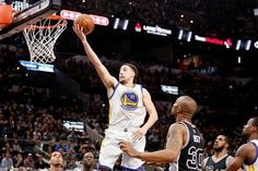 Warriors top Spurs for record-tying 72nd win