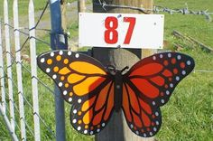 Kiwiana butterfly on the farm's front gate 87 Perkins Road