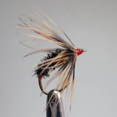 Kebari pattern: peacock hearl body, pheasant hackle and  bright red trigger point, the head.