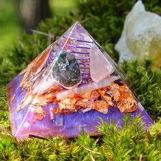 This listing is for 1 Orgone Pyramid 🔮 Scroll down to read about the crystals in this pyramid and some orgone information ✨  It contains: ♡ Quartz Crystal ♡ Rose Quartz ♡ Rhodonite ♡ Hematite ♡ Carnelian ♡ Moss Agate ♡ Selenite ♡ Brass ♡ Aluminium Shavings ♡ Love & Healing  **Measures: 2.5 square at the base by 2 tall (64mm x 4) ---------------QUARTZ CRYSTAL----------------------- Quartz Crystal is a power stone. It has been called the Universal Crystal because of its many uses. It enhan...