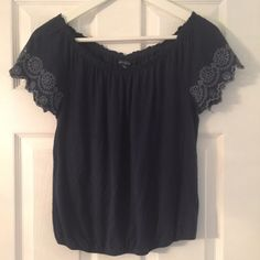 American eagle size S navy blue shirt Gently used. Size small. From American eagle and is navy blue American Eagle Outfitters Tops Tees - Short Sleeve
