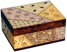 Woodburning pen is used to create a quilt design on a wood box