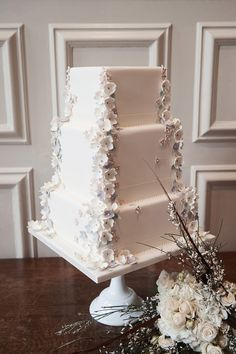 Tiny Cascading Pastel Flowers on White Tiered Cake