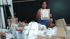Teen volunteer Prisha making a drop-off for the Food Drive!