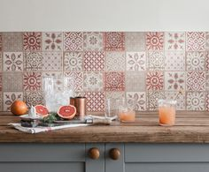 Using red patterned tiles in a country style kitchen: If you want to add some real style and personality to your kitchen, use brighter colours — but just make sure you're restrained. Consider livening up your cabinets, walls (or consider coloured tiles or wallpaper). (Photo: Gemini Tiles) #Country #tiles #interiordesign #kitchen #rusticdecor
