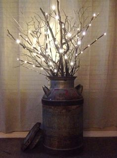LED branch lights and a few real branches in an old milk can.