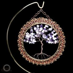 Cybele-Diana is one of our Chainmaille Framed Tree of Life Signature Collection piece, and we are thrilled to have this piece displayed at the GBK 2012 MTV Movie Awards Gift Lounge on June 1st and 2nd. This piece is handmade with 18 and  20 gauge Jeweler's Brass and Copper in a partial Byzantine Chainmaille Weave variant woven around a 4.0-inch Brass ring.  The Tree of LIfe is made with geniune Amethyst stone chips highlighted with a bit of Rose Quartz stone chips wirewrapped in 20 gauge…
