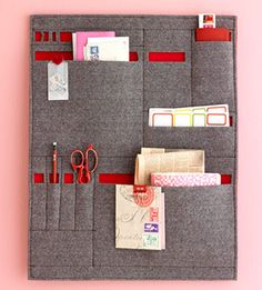 Create a fabric mail sorter and hang it in a convenient spot. The version shown here was tailored for out-going letters. Adapt it for incoming mail by including big slots for envelopes and small slots for a letter opener and a box cutter (for packages).
