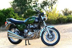 Man! I sure wanted one of these bad boys back in my youth!  - - - - - - - - - - - - - - -  Just look at those pipes. Yes, 'Sei' means six in Italian, and this is the legendary Benelli superbike from the 1970s. The 750 Sei was the first production motorcycle with a 6-cylinder engine, and instantly trumped the burgeoning Japanese triples and fours.