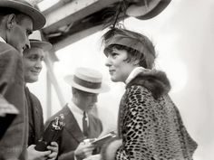 """The former teen beauty Evelyn Nesbit, shown here at age 29, achieved notoriety in 1906 when her lover Stanford White, the noted architect, was killed by her husband, Harry Thaw. August 5, 1914. New York. """"Evelyn Thaw arriving from Southampton on White Star liner Olympic."""""""