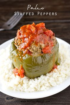 Paleo Stuffed Peppers >> by Tastes of Lizzy T's. Paleo Stuffed Peppers are filled with seasoned ground sirloin and slow cooked to perfection. Served with cauliflower rice and smothered in spaghetti sauce.