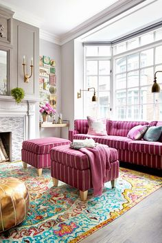 Perhaps a greige/mole color might be better for living room than pure white, especially if lighting isn't good. Same color as your chairs, so they'll blend a bit, but still stand on their own with pattern. This color on walls looks gorgeous with your fushia/peacock/gold color scheme.