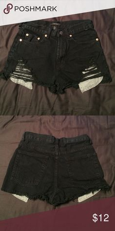 Highwasted Shorts Forever 21 black high wasted shorts with rips towards the bottom. Also has a long visible gray pocket peeking out from the bottom of the shorts. Very fashionable. Forever 21 Shorts Jean Shorts