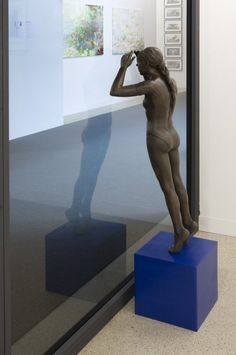 """""""Come up on different streets, they both were streets of shame or absinth blurs my thoughts, I think we should be moving on"""", 2009 // A bronze figurine of a young female ballerina resembling Degas' dancer stands atop upon an ultramarine blue cube to peer through the window of the front of the gallery space. Her hands are at the sides of her face, directing her gaze and shading her view from the reflections or shadows. Her abandoned plinth stands in the corner of the gallery. // Click on """"Visit""""! Ryan Gander, Degas Dancers, Inspirational Artwork, Through The Window, Young Female, Amazing Art, Shadows, Ballerina, Abandoned"""