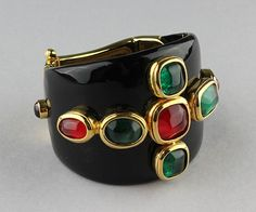 Robert Goossens of Paris Cuff, Goossens Maltese black cuff with large faux jewels framed in goldtone metal with a dramatic goldtone closure. Goossens designed for Madame Gres, Chanel, Balenciaga, Yves Saint Laurent, and Christian Dior. In 2005 Chanel bought Goossens' s company, Potomack Company, Design Online Auction, Dec. 9, 2014, Lot 1001