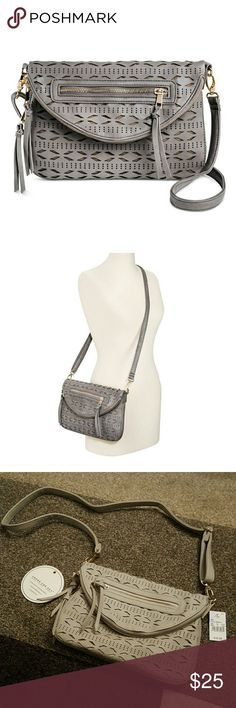 NEW! Under One Sky Crossbody Bag BRAND NEW WITH TAGS!! Grey faux leather cross body bag from Under One Sky! (closely resembles a Jessica Simpson bag) both Zip and Snap closure. Reversible Flap! Unsnap and flip the flap for 2 looks in 1! Gold hardware. Dimensions: 11 inches (H) x 12.75 inches (W) x 1 inch (D). One zipper compartment on front, one zipper compartment and 2 cellphone compartments inside. NO TRADES. Under One Sky Bags Crossbody Bags