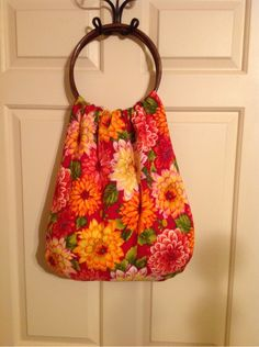 My first attempt at making a bag with wooden handles. I made my own pattern and it's not perfect but it turned out cute. It is reversible.