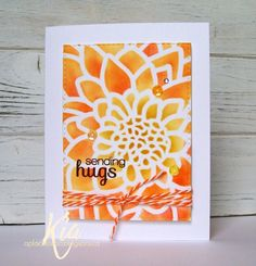 handmade card: Sending hugs CAS390 ... stenciled flower panel ... Distress Inks in yellow and oranges ... like how the black stamped sentiment stands out on top ...