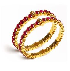 a traditional south indian setting, cob rubies in 22kt gold